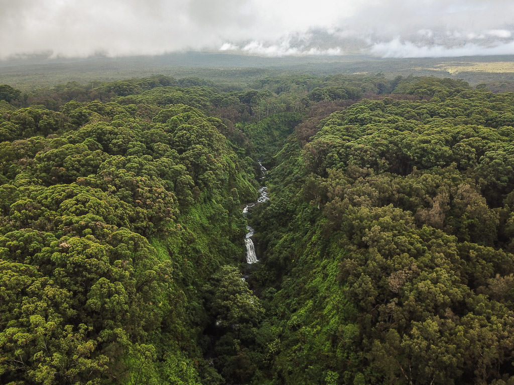 Waterfall going through a canyon far off the Road to Hana that we found while exploring using the drone